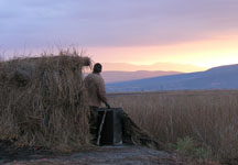 Hunter in hut at dawn in the Bear Lake Valley